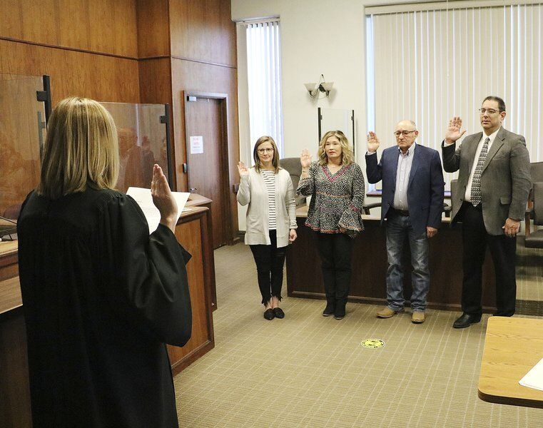 County officers start new terms