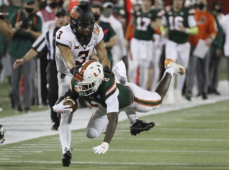 Cowboys start fast, defeat Miami in Cheez-It Bowl