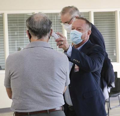 Health team looks at old hospital