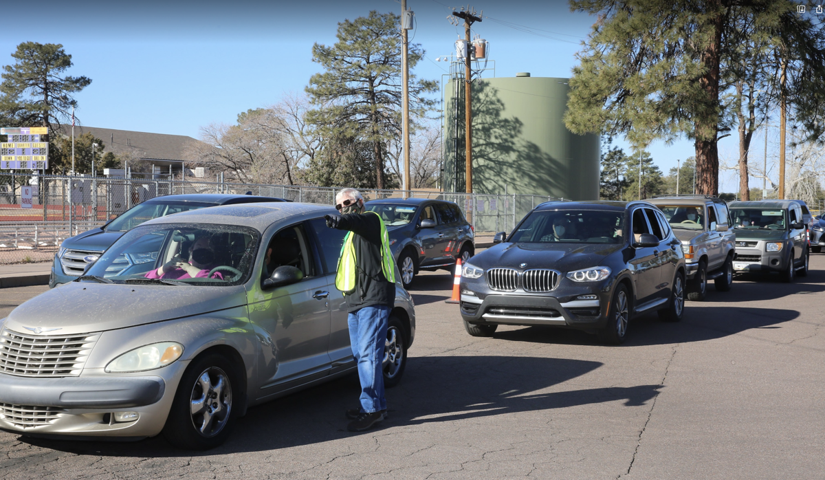 Cars lined up to wait for vaccine during Feb. 27 clinic
