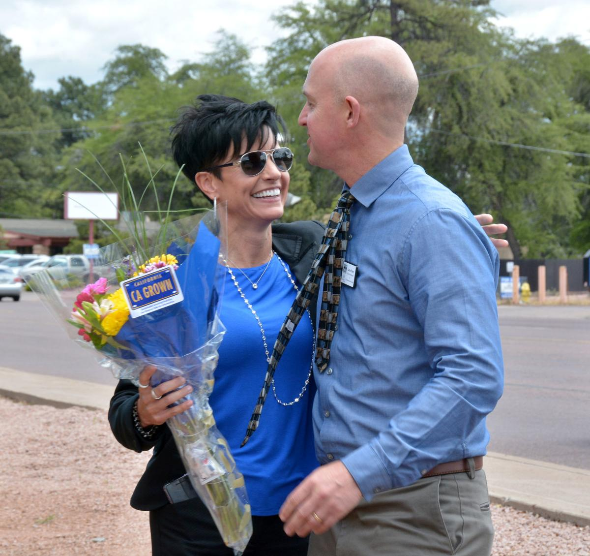Chamber - Lance Porter gives Maia Crespin flowers on work anniversary