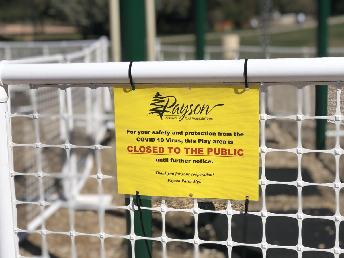 Sign on the fences closing Payson parks