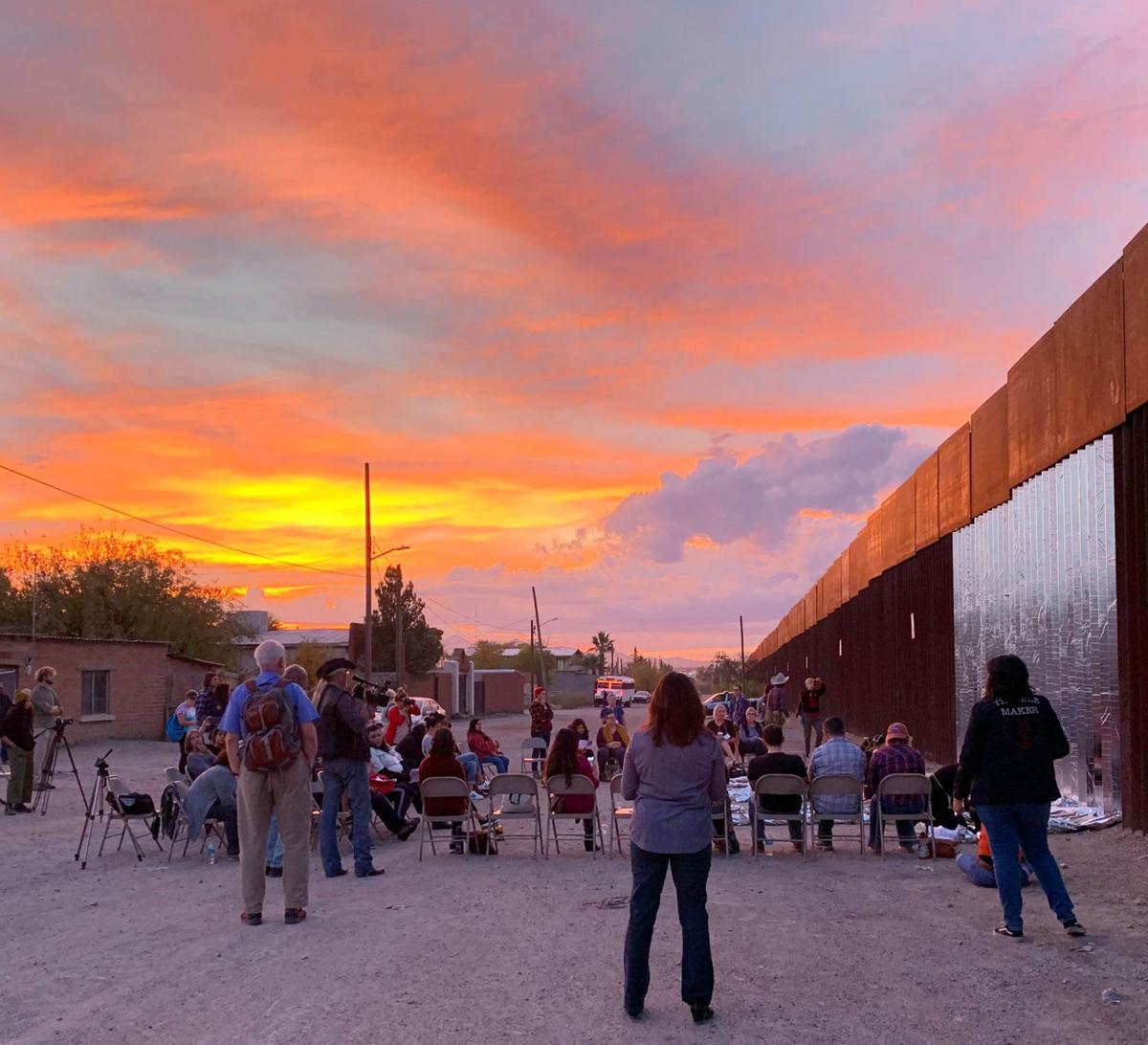 Group - Lisa Tan border wall mylar at sunset