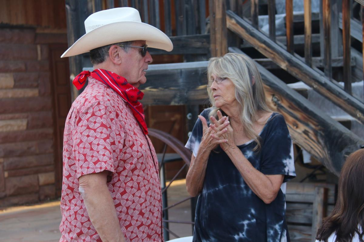 Minette Hart, chair of the Main Street Guild, speaks with Tom Morrissey, mayor of Payson,