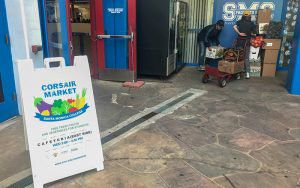 Students at Caifornia's Santa Monica College help set up the school's weekly Corsair Market