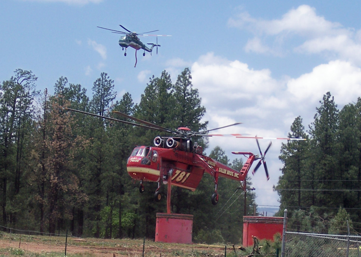 A helicopter fills its water tanks at a Gila County tank