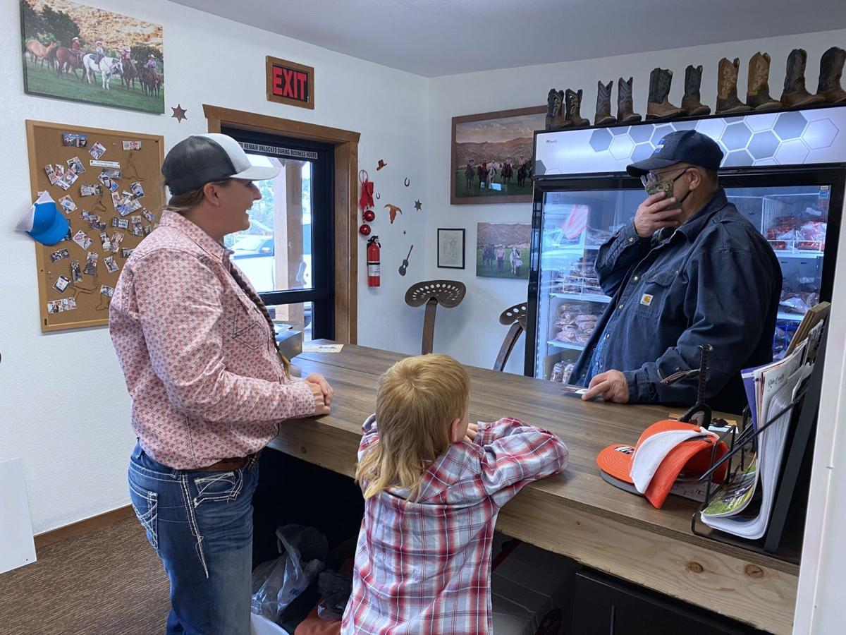 Cassie and Pratt Lyman with customer at beef shop