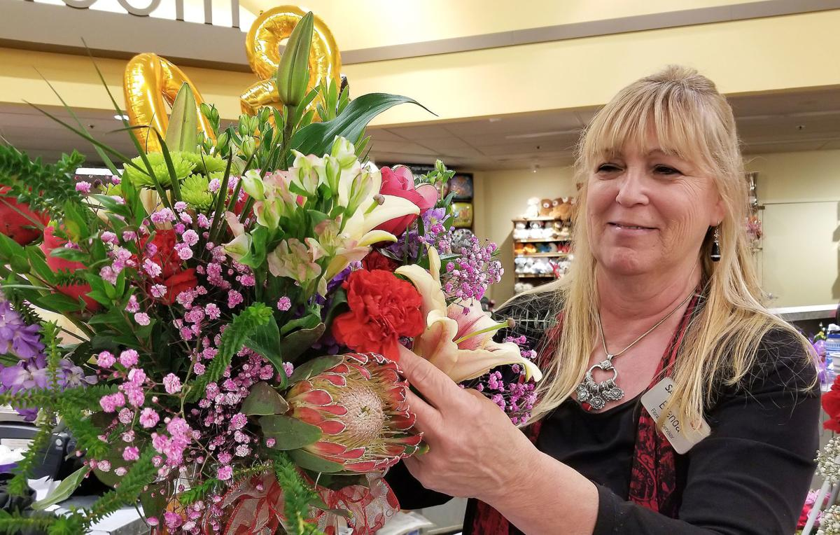 Brenda Wolf works on a special order at Safeway