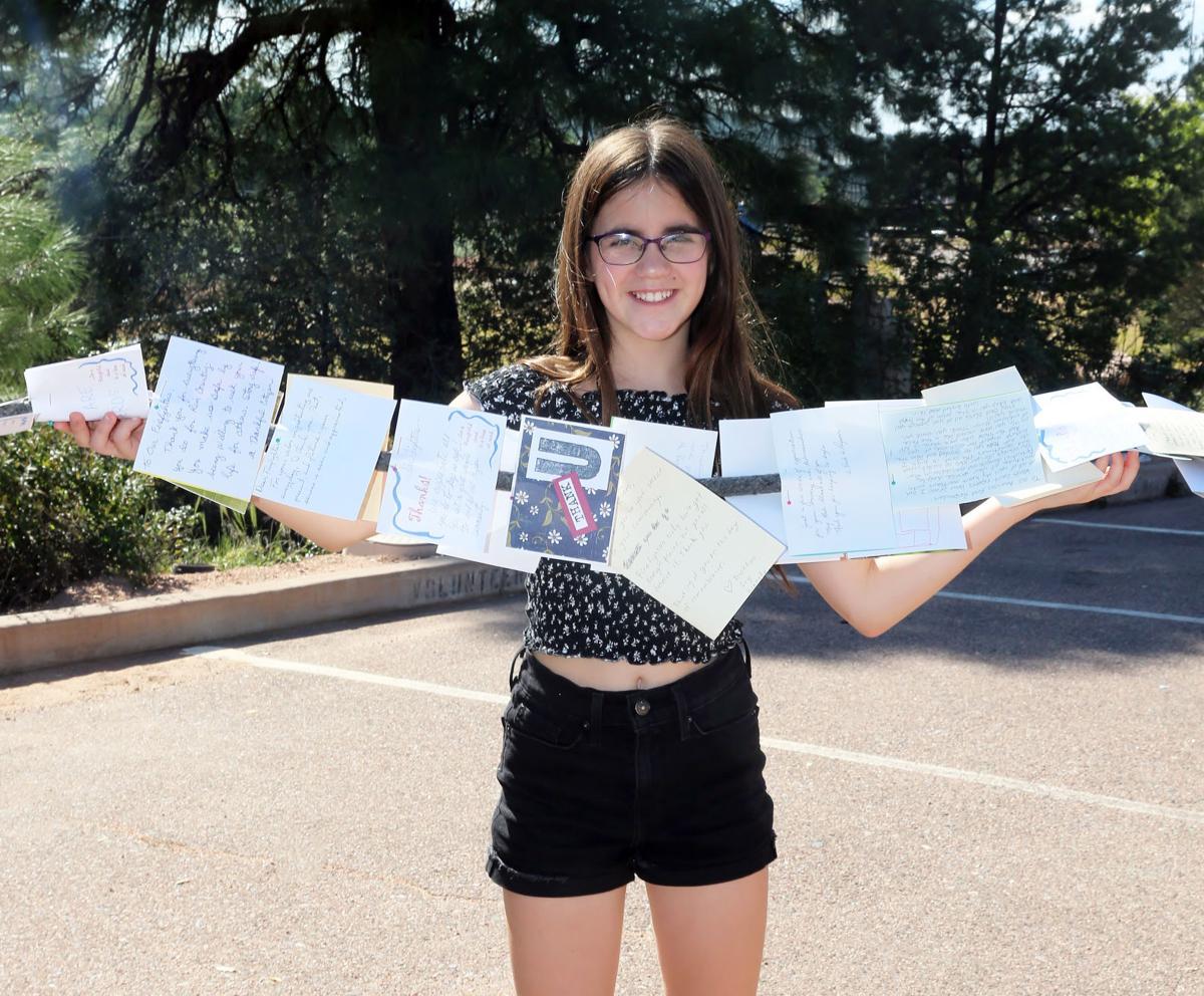 Girl holding postcards