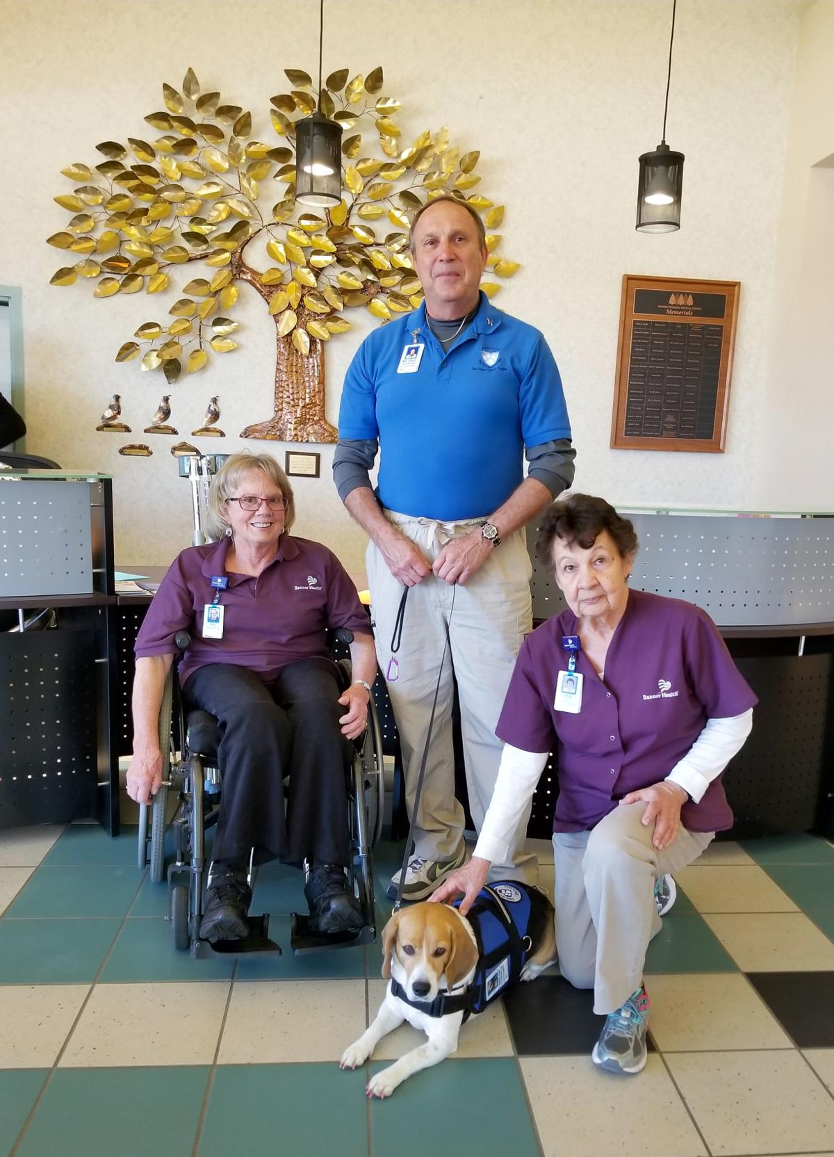 Michael Colombo and Shiloh with hospital volunteers