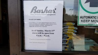 Bashas' new hours sign