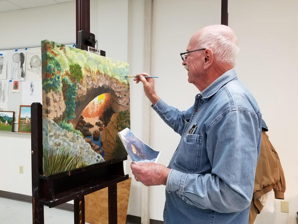 Robert Hershberger putting the finishing touches on his painting of Tonto Natural Bridge