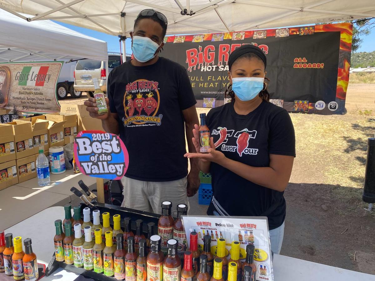 Paul and Tasia Ford with Big Red's hot sauce June 27 Payson Farmers Market