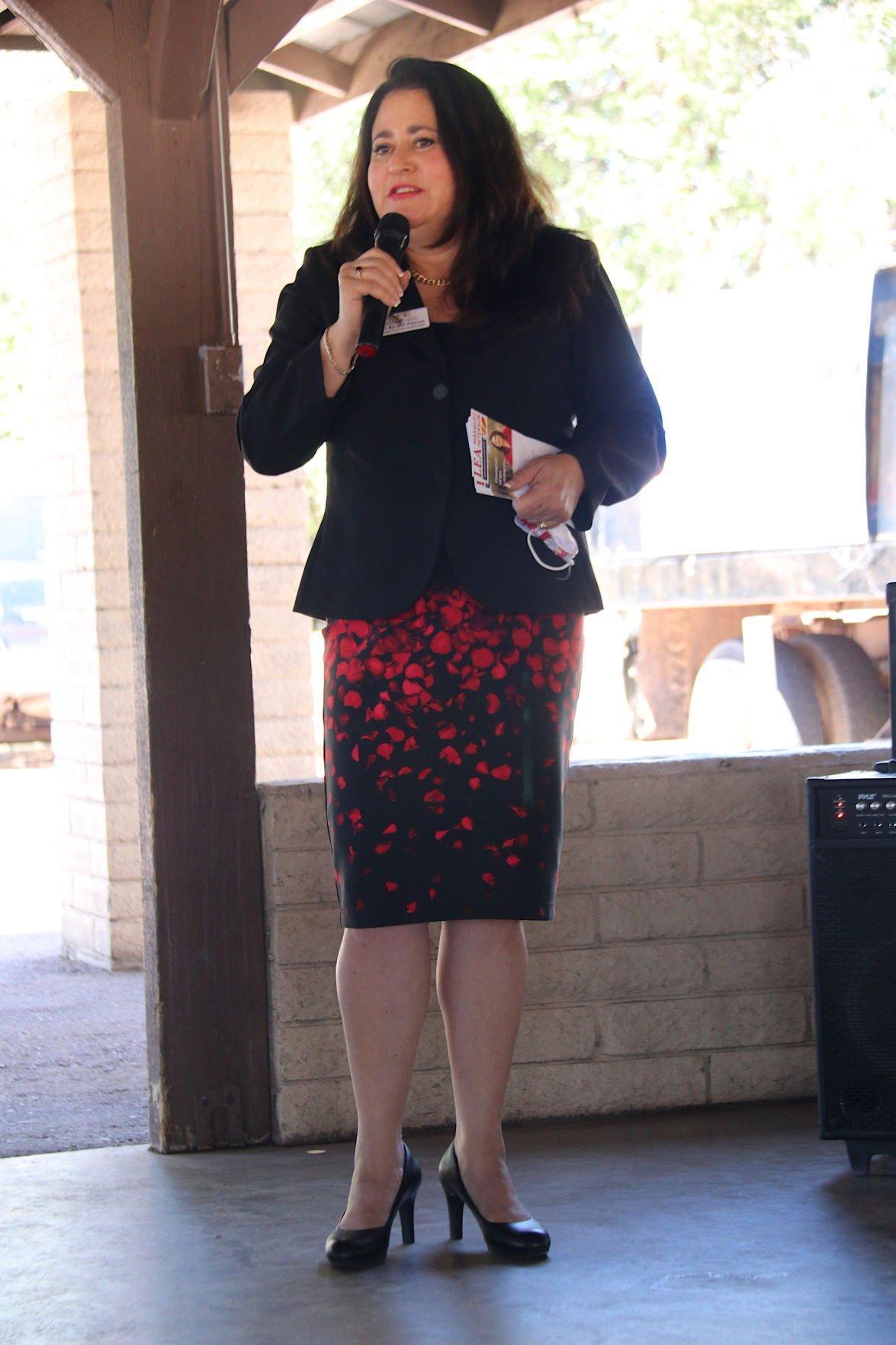Lea Márquez Peterson head to toe shot speaking