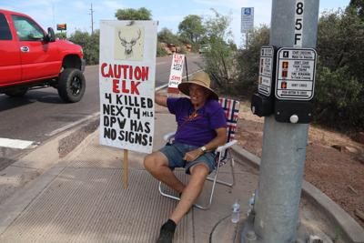 Stan Wilkenson smiling car elk signs