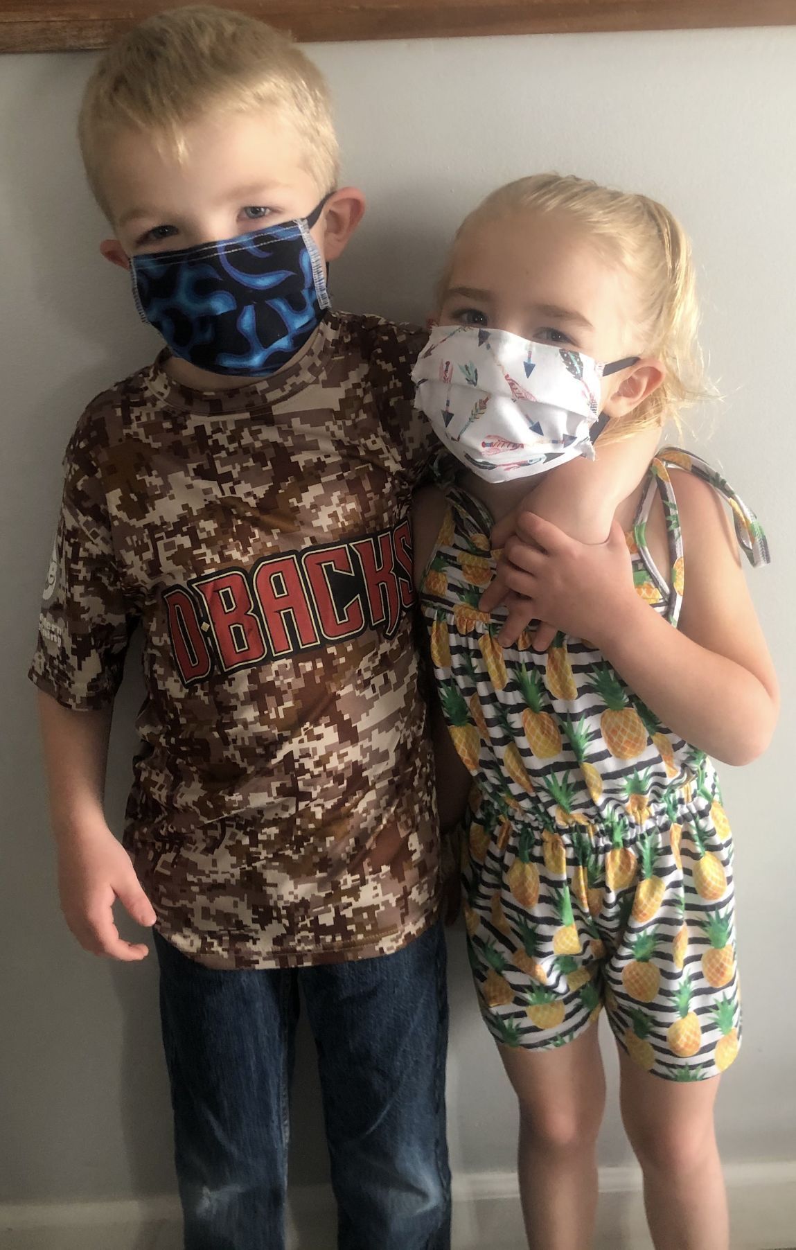 Wyatt and Sage Brooks with face masks
