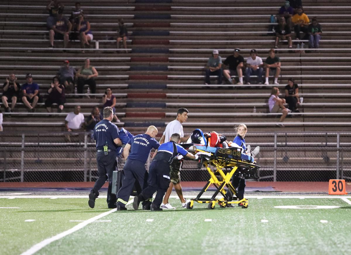 Football Player On Stretcher
