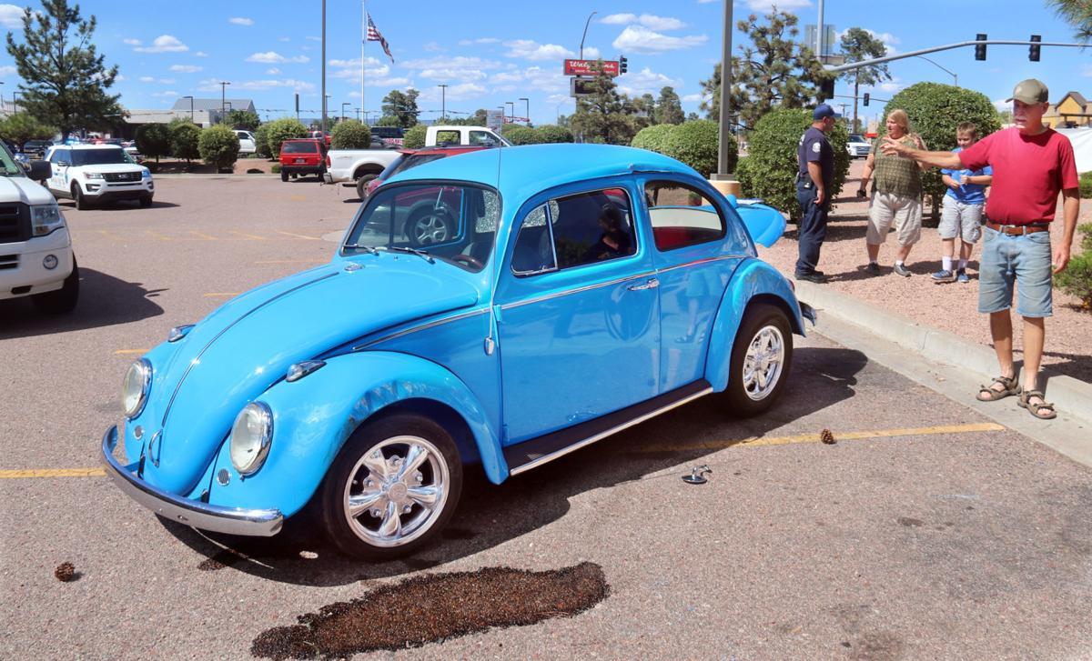 1963 VW bug flip walgreen parking lot