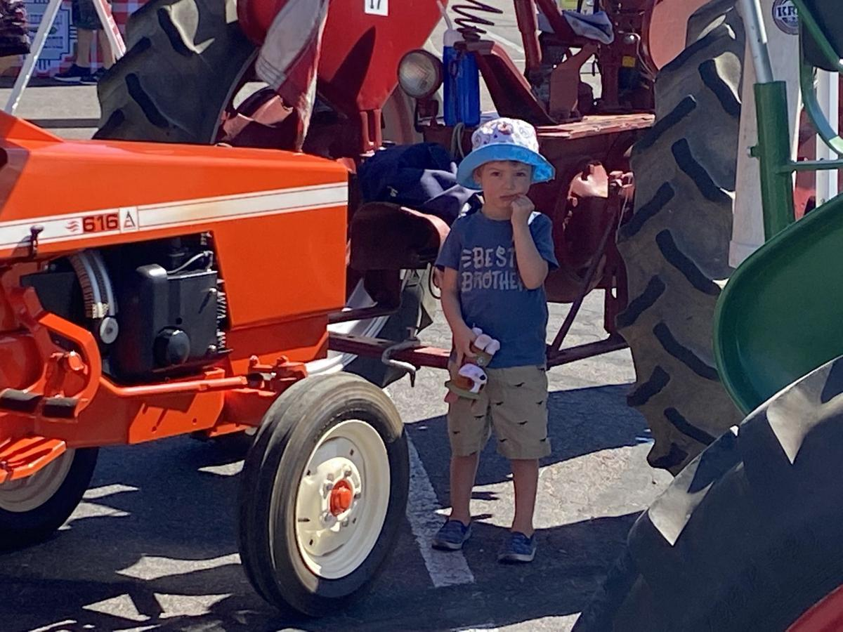 Rim Country Tractor Club at Payson Farmers Market child in tractors