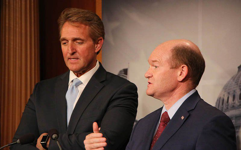 Sens. Jeff Flake, R-Arizona, left, and Chris Coons, D-Delaware