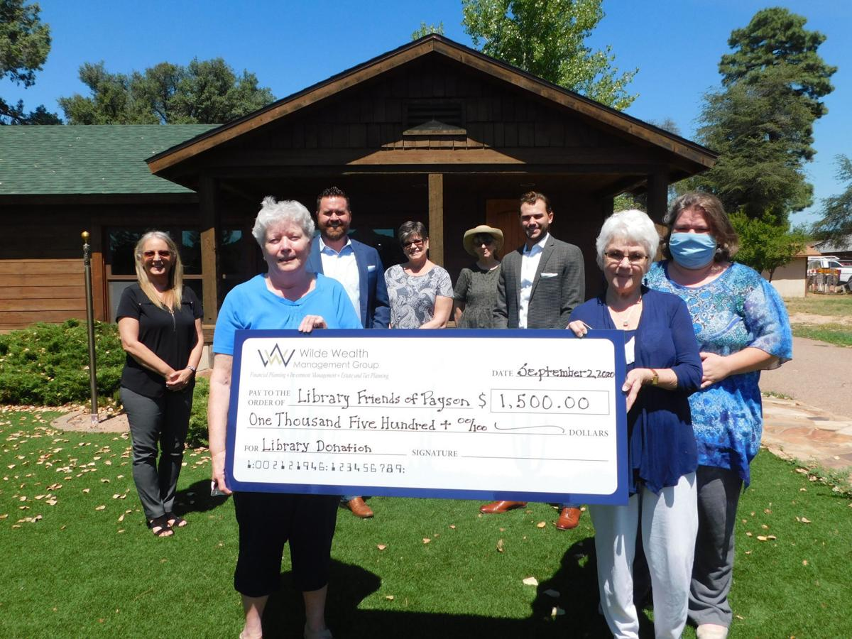 Wilde Wealth Management Presents Check To Payson Public Library