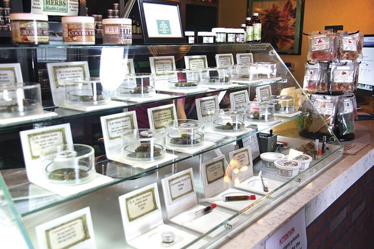 Dispensary products behind glass