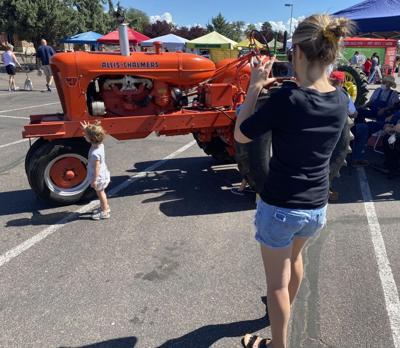 Family checks out the tractors of the Rim Country Tractor Club at Payson Farmers Market