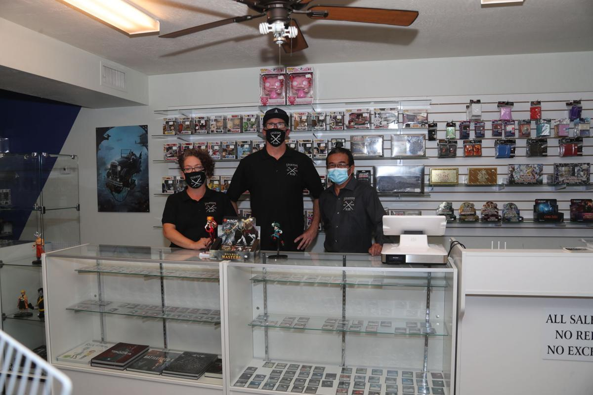 Legends of the Rim Owners Behind Counter Wide Shot