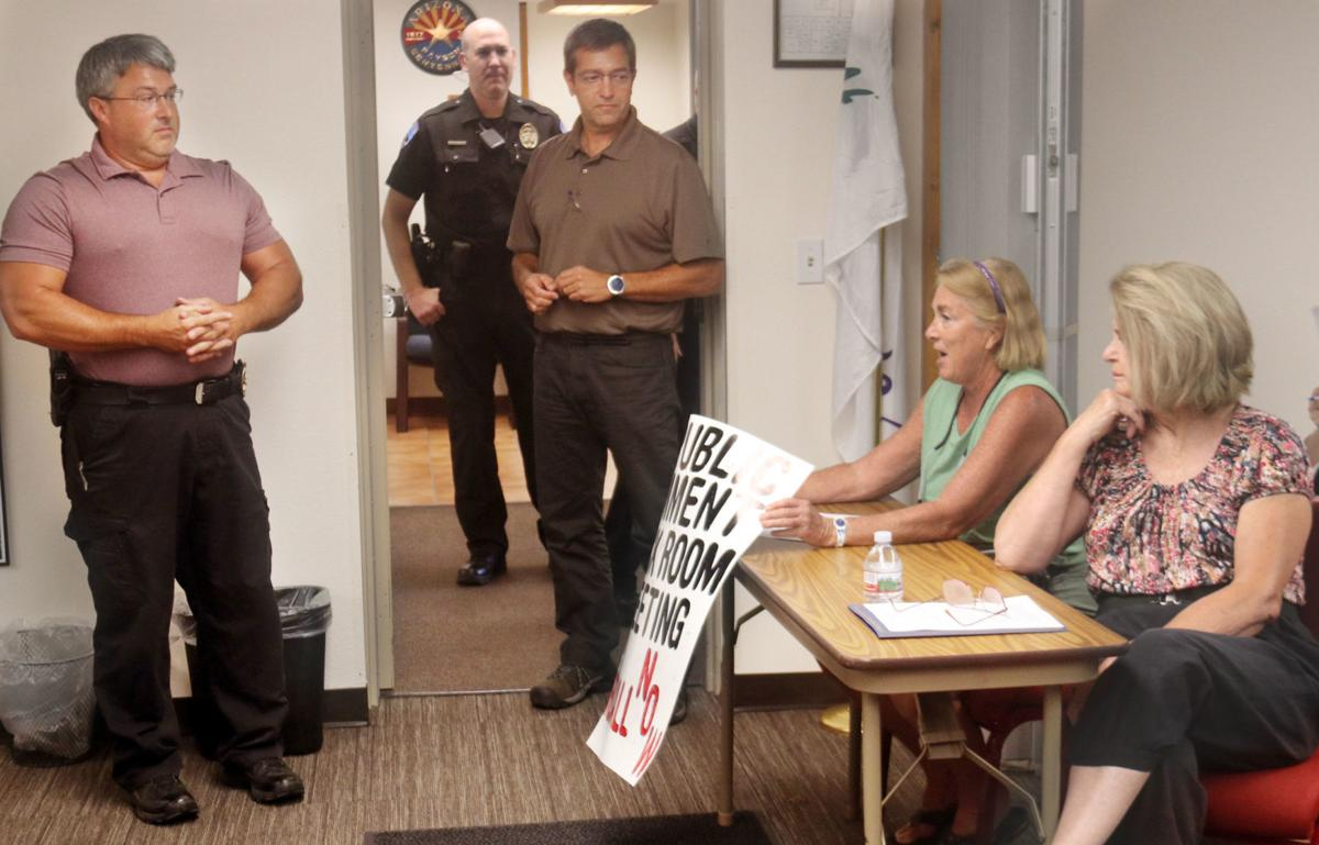 protester tossed margie oldencamp recall sign