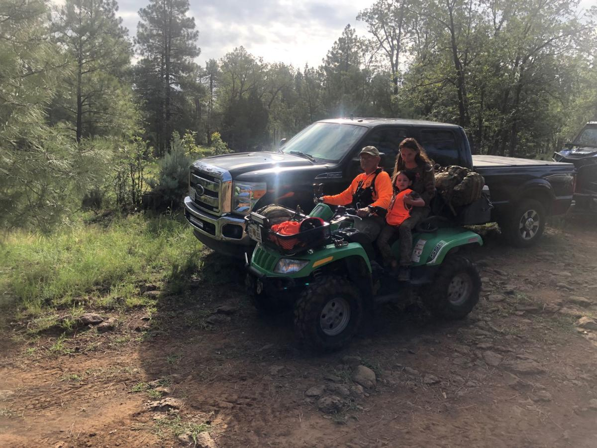Mother and daughter on quad
