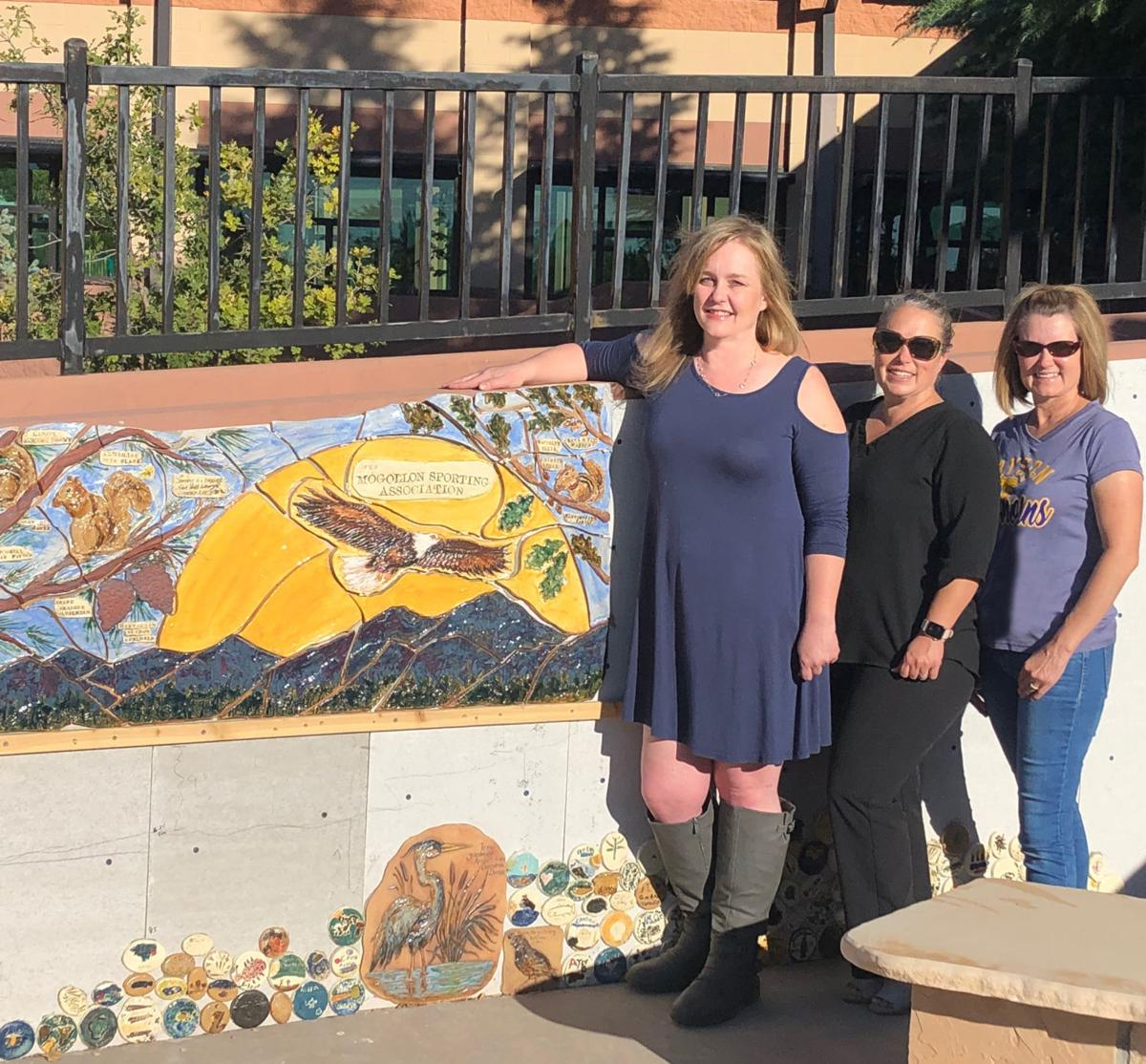 Sarah Linkey (left), Audrey Hogue (center) and Jolynn Schinstock at the installation of the donor wall at Julia Randall Elementary.