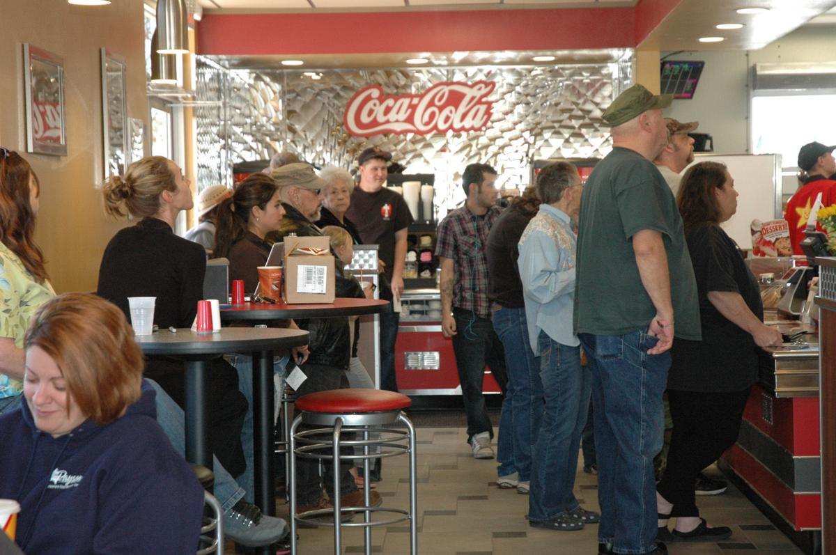 Carl's Jr. stock photo of fast food crowd