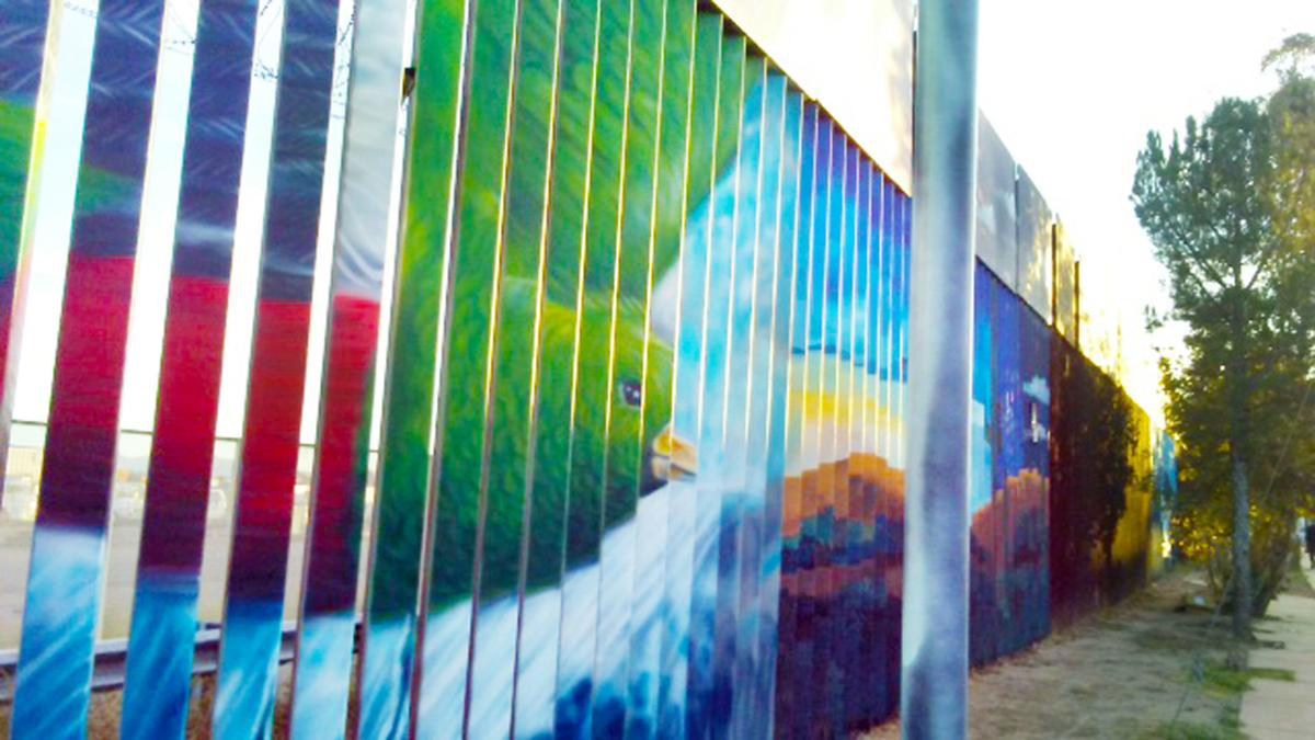 Birds on wall Lisa Tan border wall mission