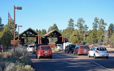 Cars line up to enter at the south entrance to the Grand Canyon in this file photo