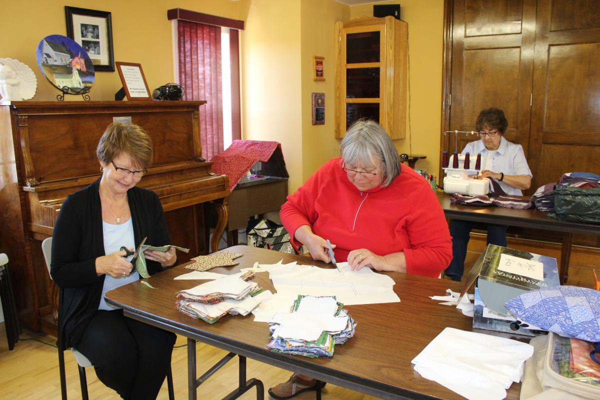 Island women use sewing skills to help girls in Africa