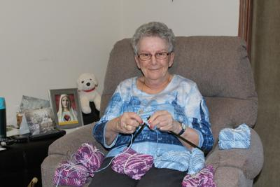 Senior knits a thousand washcloths for a good cause