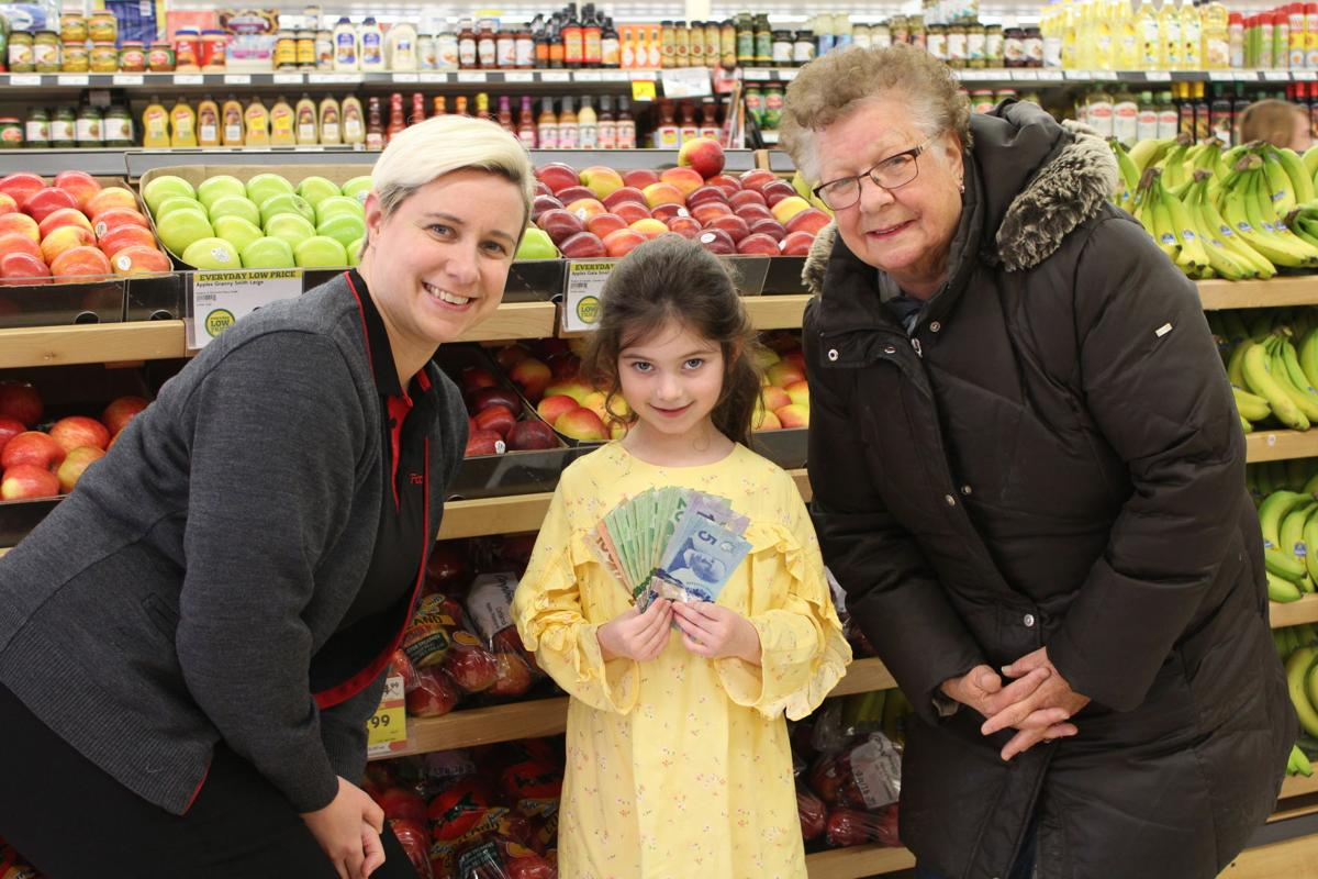 Little girl uses birthday money to purchase items for local food bank