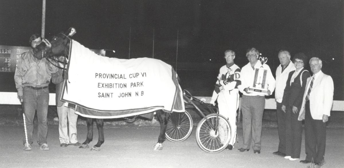 Jim Doherty in winners circle at EPR after winning Provincial Cup with Nero's BB for owner Milton Downey.jpg