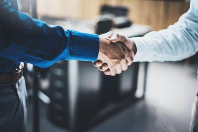 Business partnership handshake concept.Closeup photo of two businessmans handshaking process.Successful deal after great meeting.Horizontal, blurred background.