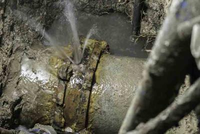Couple of asbestos cement water pipe broken