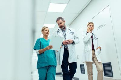 Emergency paramedic team in hospital hallway