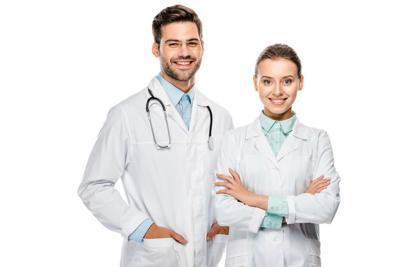 handsome happy male doctor standing near female colleague with crossed arms isolated on white
