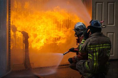 Fireman training and fighting burning fire