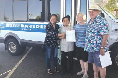 Bellevue Heights Church donates bus to help refugees