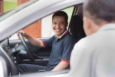 man talking to car driver