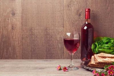 53032880 - passover celebration with wine and matzoh over wooden background