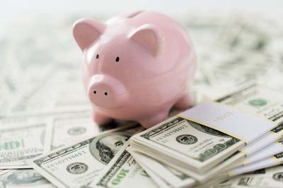 close up of dollar money and pink piggy bank