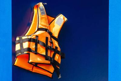 Life vest on blue wall background Pool and Boat Safety guard