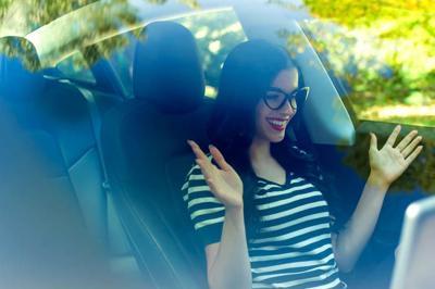 Woman in an autonomous vehicle