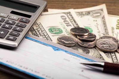 Checkbook, Pen, Calculator and Money - Close Up